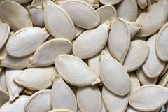 Vegetal background. Closeup of pumpkin's seeds as a background stock photo