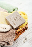 100% vegetal soap. Enriched with Shea Butter, 100% vegetal soap with bath towels and bath sponge in bowl closeup royalty free stock photos