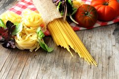 Vegetal spaghetti raw pasta and tomatoe for sauce Royalty Free Stock Photo