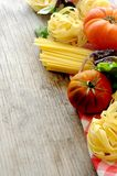 Vegetal spaghetti raw pasta and tomatoe for sauce Stock Photography