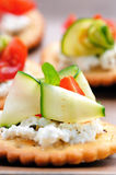 Vegetarian appetisers. Bite size canapes with ricotta cheese and zuchinni Royalty Free Stock Photo