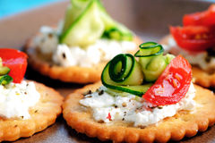 Vegetarian appetisers. Bite size canapes with ricotta cheese, zuchinni and tomato Stock Photo