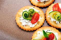 Vegetarian appetisers. Bite size canapes with ricotta cheese, zuchinni and tomato Stock Photos