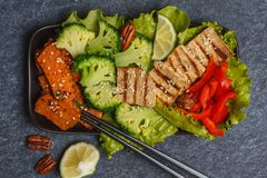 Vegetarian asian salad with sweet potato, grilled tofu, broccoli