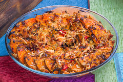 Vegetarian baked dish of orange pumkin, vegetables, herbs, chees Royalty Free Stock Photo