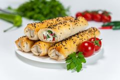Vegetarian baked rolls section on white plate royalty free stock photos