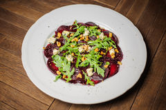 Vegetarian Beetroot Carpaccio with goat cheese and Pesto Stock Photos