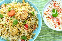 Vegetarian biryani or vegetarian pilaf served with yogurt dip or raita. Biryani, biriani, or beriani is a set of rice-based foods made with spices, rice usually Royalty Free Stock Image