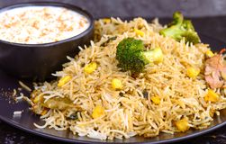 Vegetarian biryani or vegetarian pilaf. Biryani, biriani, or beriani is a set of rice-based foods made with spices, rice usually basmati and meat, fish, eggs or Stock Photos