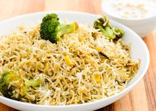 Vegetarian biryani or vegetarian pilaf. Biryani, biriani, or beriani is a set of rice-based foods made with spices, rice usually basmati and meat, fish, eggs or Stock Images