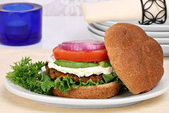 Vegetarian black bean burger on a whole wheat roll. Stock Image