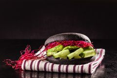 Vegetarian Black bun burger with cucumbers and sprouts. stock photo