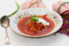 Vegetarian borsch. Lenten soup a borsch with sandwiches from black bread and sausage Royalty Free Stock Photo