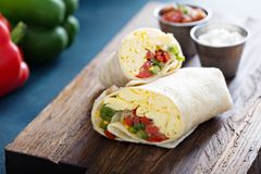 Vegetarian breakfast burrito with eggs. And bell pepper stock image