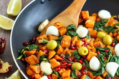 Sweet Potato Breakfast Hash. Vegetarian breakfast option sweet potato hash with olives, mozzarella and spinach royalty free stock images