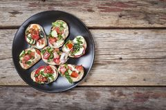 Healthy food, vegetarian bruschetta, Italian food, basil, mozzarella, tomatoes, Top view with space for text. copy space stock images