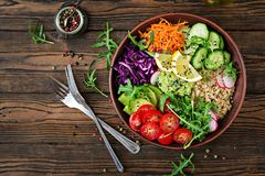 Buddha bowl lunch with grilled chicken and quinoa, tomato, guacamole. Vegetarian Buddha bowl with quinoa and fresh vegetables. Healthy food concept. Vegan salad Stock Images