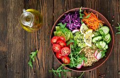 Vegetarian Buddha bowl with quinoa and fresh vegetables. Royalty Free Stock Images