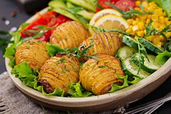 Vegetarian buddha bowl. Raw vegetables and baked potatoes in bowl. Vegetarian buddha bowl. Raw vegetables and baked potatoes in  bowl. Vegan meal. Healthy and Stock Photo