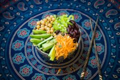 Vegetarian buddha bowl. Raw vegetables and beans in a one bowl. royalty free stock image