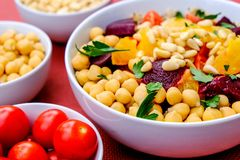 Vegetarian Bulgur Wheat and Quinoa Lunch Bowl. With Orange Segments, chickpeas, Beetroot and Tomatoes stock photography