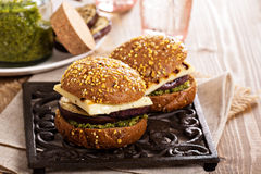 Vegetarian burger with cheese, eggplant and pesto Royalty Free Stock Photo