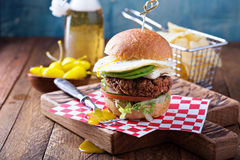 Vegetarian burger with egg and avocado Stock Image