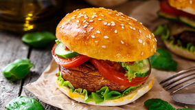 Vegetarian burger with grilled champignon. Tomato and cucumber stock image