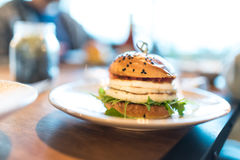 Vegetarian burger with grilled haloumi. Rocket salad and tomato sauce Royalty Free Stock Image