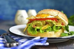 Vegetarian burger with guacamole and roasted egg. Stock Image