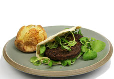 Vegetarian burger in Pitta bread with Baked Potato Royalty Free Stock Photo