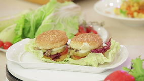 Vegetarian burger on a plate stock video footage