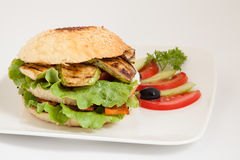 Vegetarian burger with zucchini, carrots, tomato and cucumber Stock Photo