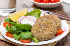 Vegetarian burgers made from lentils and buckwheat on the plate Royalty Free Stock Images
