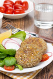 Vegetarian burgers made from lentils and buckwheat, vertical Royalty Free Stock Photo