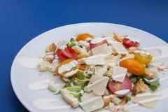 Vegetarian Caesar salad. On white plate Stock Photo