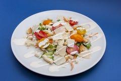 Vegetarian Caesar salad. On white plate Stock Photos