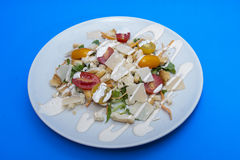 Vegetarian Caesar salad. On white plate Royalty Free Stock Photography