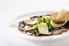 Vegetarian carpaccio with beetroot,nuts and toast Royalty Free Stock Images