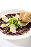 Vegetarian carpaccio with beetroot,nuts and toast Stock Photos