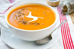 Vegetarian carrot-pumpkin cream soup with garlic and cumin Stock Photo