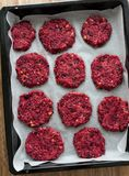 Vegetarian Chickpea and beetroot burgers Stock Photography