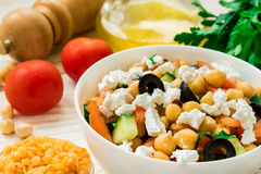 Vegetarian chickpea greek salad and red lentil Royalty Free Stock Photos