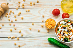 Vegetarian chickpea salad with olives, feta, tomatoes, onion and garlic Royalty Free Stock Images