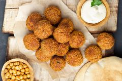 Vegetarian chickpeas falafel balls on wooden rustic board stock photography