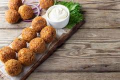 Vegetarian chickpeas falafel balls on wooden rustic board. Traditional arabian food.  stock image