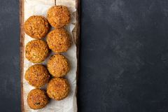 Vegetarian chickpeas falafel balls on wooden rustic board royalty free stock photography