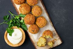 Vegetarian chickpeas falafel balls on wooden rustic board. royalty free stock photo