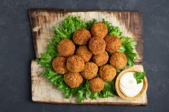 Vegetarian chickpeas falafel balls on wooden rustic board. Traditional Middle Eastern and arabian food. royalty free stock image
