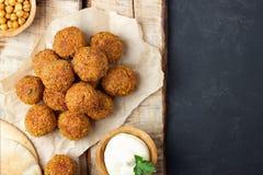 Vegetarian chickpeas falafel balls on wooden rustic board stock photos
